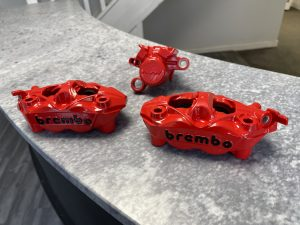 motorbike callipers powder coated in red