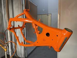 a metal bike frame powder coated in orange