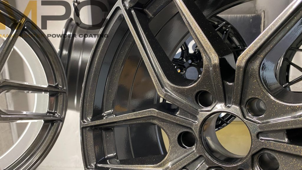A wheel in BMW Orbit Grey II with Gold Star Lacquer