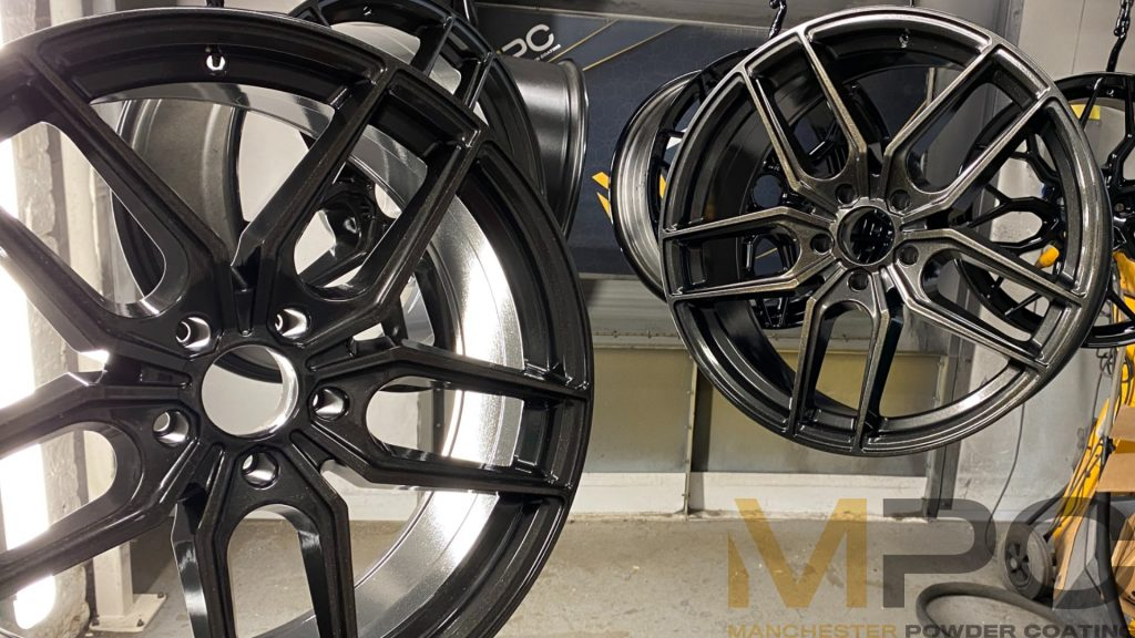 Grey and gold wheels hanging in the workshop